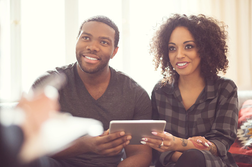 Afro American Couple Talking With Financial Advisor Stock Photo - Download Image Now