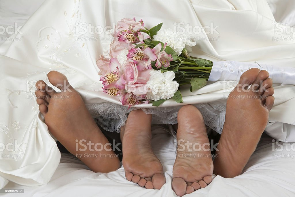 Afro- American feet on wedding night An Afro American couple make love on their wedding nightPeople images Adult Stock Photo