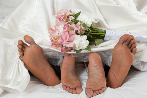 Afro American Feet On Wedding Night Stock Photo - Download Image Now