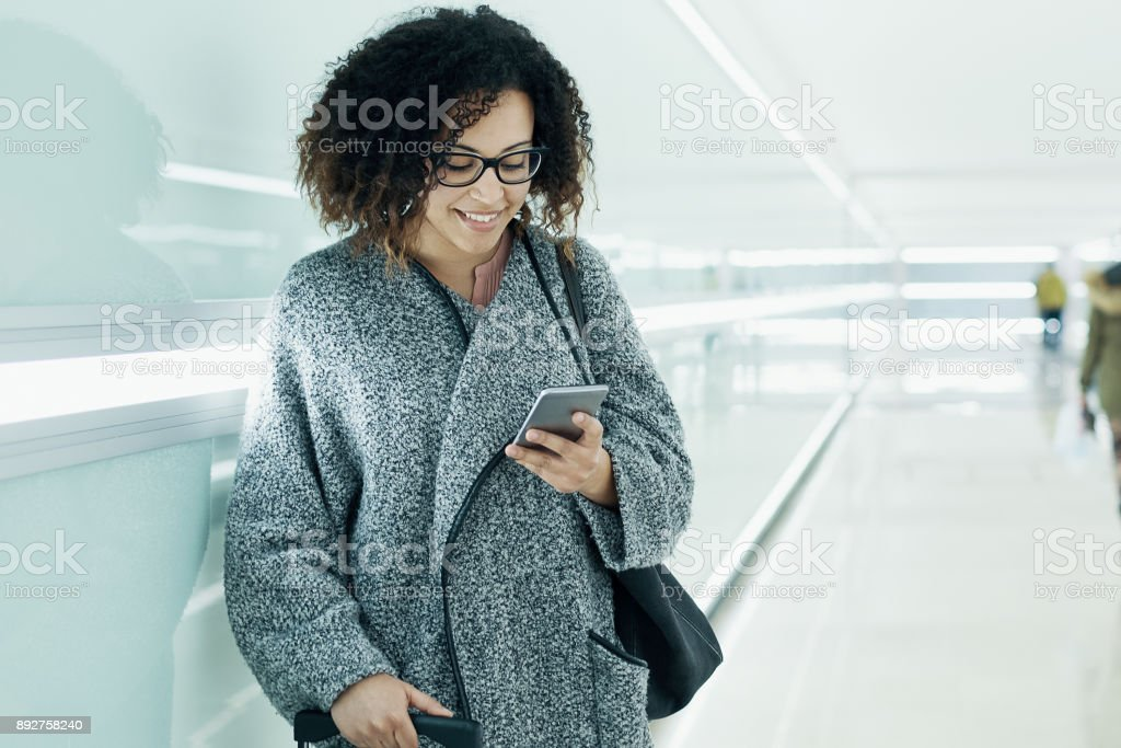 Afro american girl using mobile phone stock photo