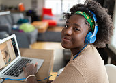 istock Afro American girls using laptop to connect with her friend 1220557346
