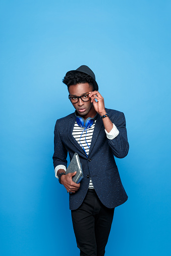 Afro American Guy In Fashionable Outfit Holding Notebook Stock Photo - Download Image Now
