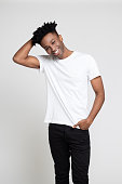 istock Afro american guy posing on white background. 1065785120