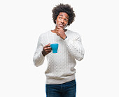 Afro american man drinking cup of coffee over isolated background serious face thinking about question, very confused idea