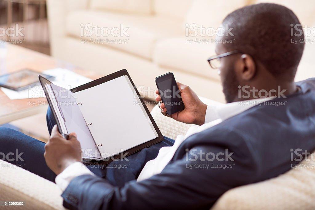 Afro American man holding a folder stock photo