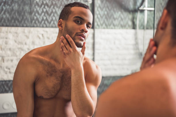 261 Mirror Looking Naked Men Stock Photos, Pictures & Royalty-Free Images -  iStock