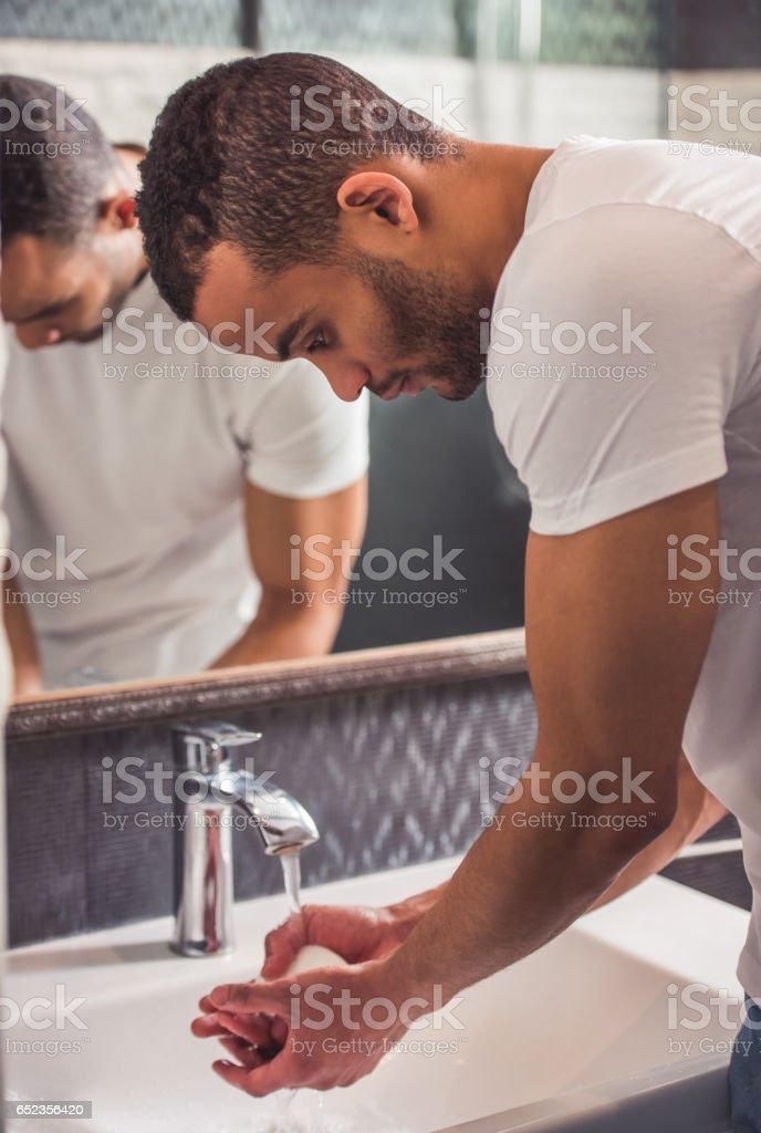 Afro American man in bathroom stock photo