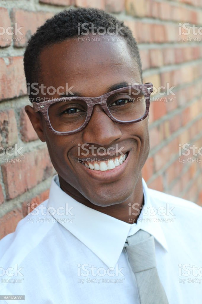 Afro American man in classic outfit smiling royalty-free stock photo