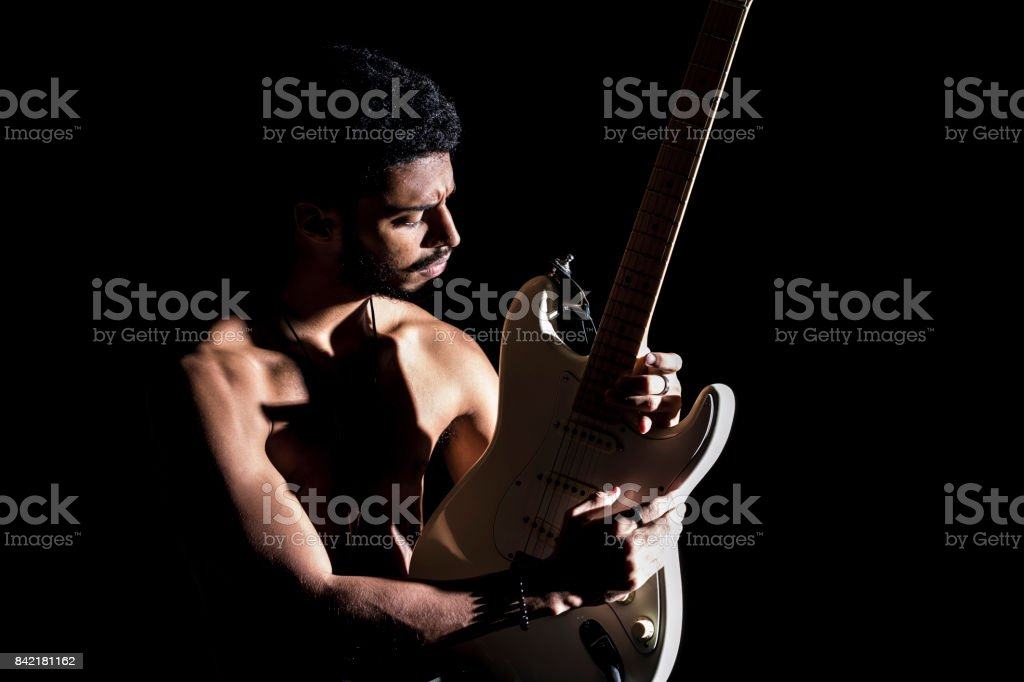 Afro American man playing electric guitar stock photo