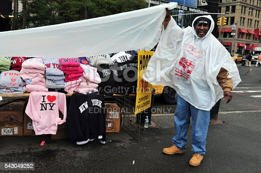458128003 istock photo Afro American man selling I LOVE NY shirts in Manhattan 543049252