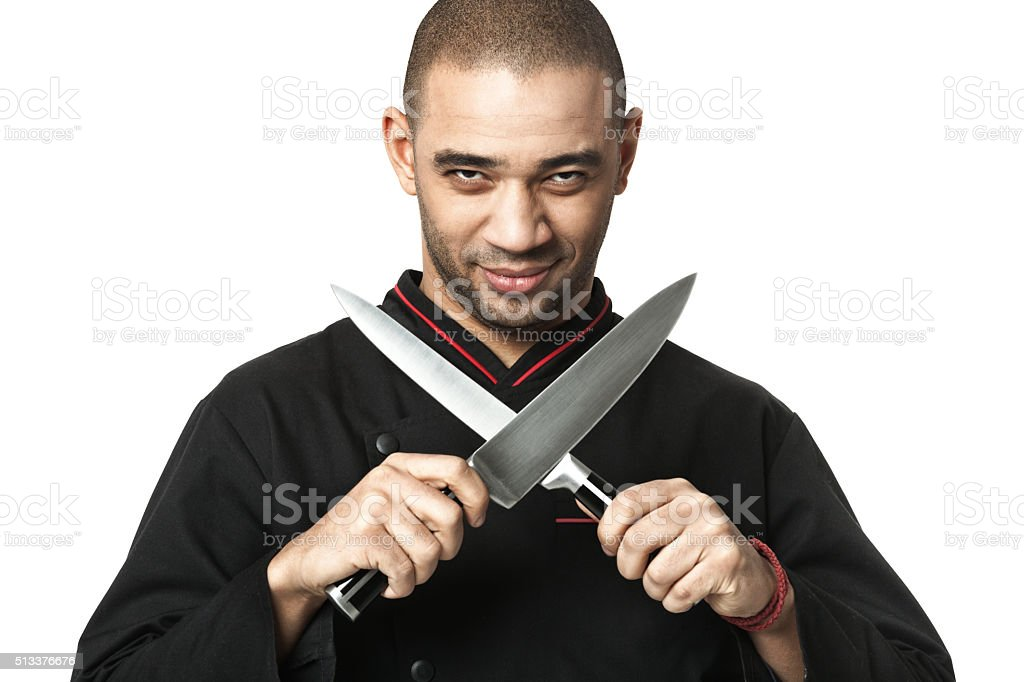 Afro American professional cook holding knifes - isolated. stock photo