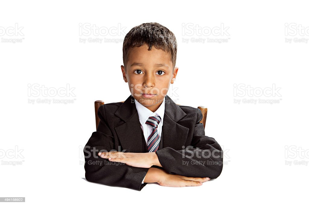 Afro american student sit at the desk with folded hands. stock photo