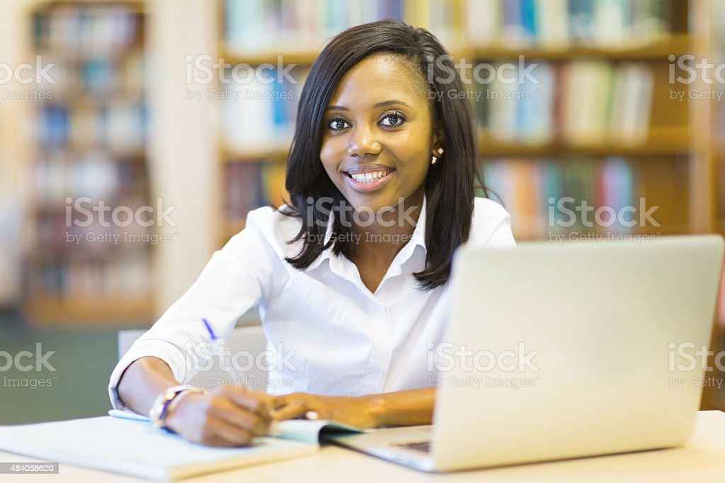 afro american student sitting in college library stock photo