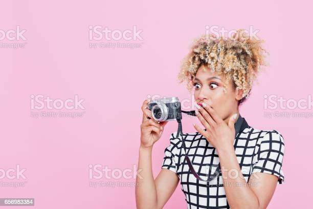 Afro American Surprised Woman Photographing Stock Photo - Download Image Now