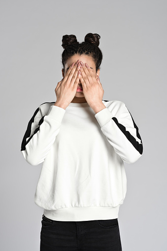 Afro American Teenager Woman Covering Eyes With Hands Stock Photo - Download Image Now