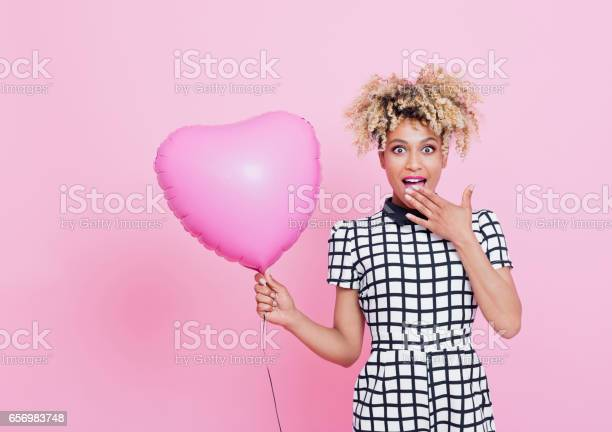 Afro American Woman Holding Pink Balloon Stock Photo - Download Image Now
