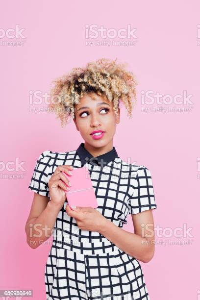 Afro American Woman Holding Pink Notes Stock Photo - Download Image Now