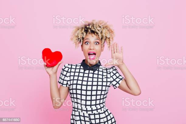 Afro American Woman Holding Red Heard And Shouting Stock Photo - Download Image Now