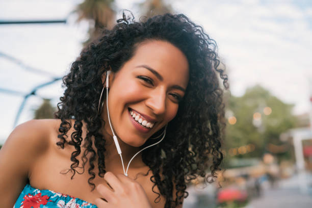 Afro american woman listening music stock photo