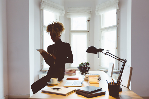 Afro American Woman Using A Digital Tablet In An Office Stock Photo - Download Image Now