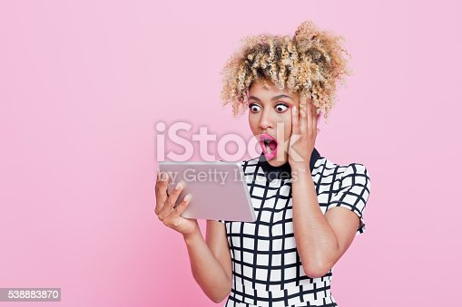 istock Afro american woman using a digital tablet 538883870