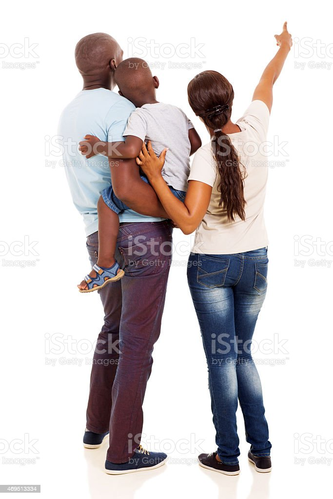 afro american young family pointing at empty space stock photo