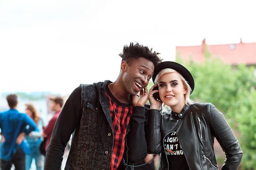 Afro American Young Guy And Blonde Girl Using Mobiles Outdoor Stock Photo - Download Image Now