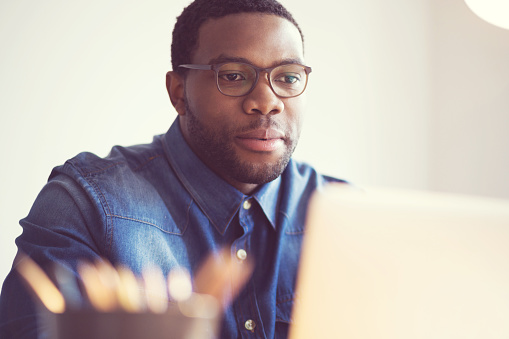 Afro American Young Man In A Home Office Stock Photo - Download Image Now