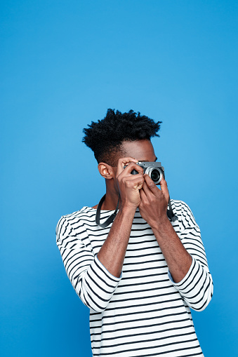Afro American Young Man Photographing Stock Photo - Download Image Now