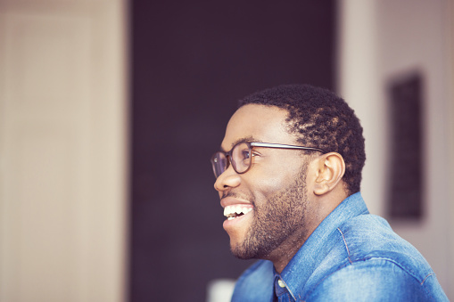 Afro American Young Man Smiling Side View Stock Photo - Download Image Now