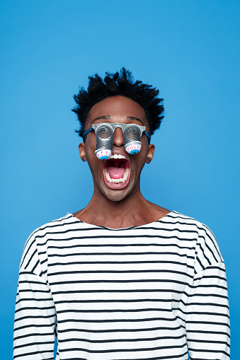 Afro American Young Man Wearing Funny Eyes Mask Stock Photo - Download Image Now