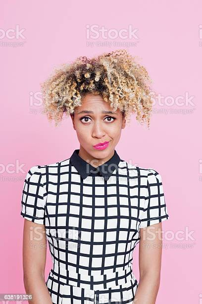 Afro American Young Woman Having A Doubts Stock Photo - Download Image Now
