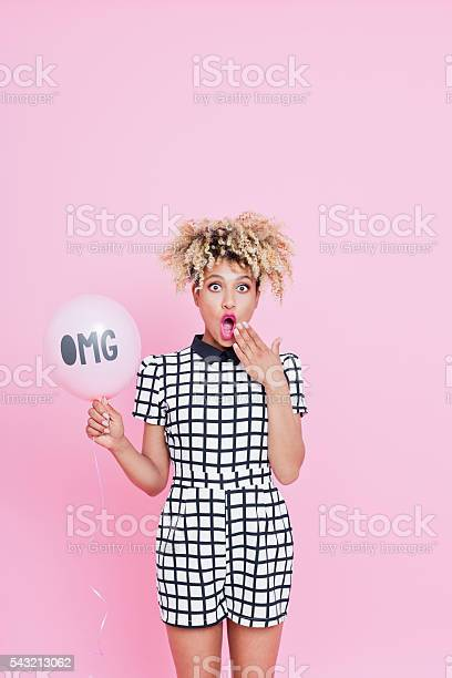 Afro American Young Woman Holding Balloon With Omg Sign Stock Photo - Download Image Now