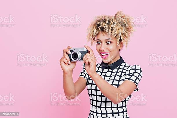 Afro American Young Woman Holding Camera Stock Photo - Download Image Now