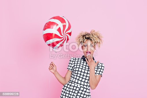 538883870istockphoto Afro American young woman holding candy balloon 538899228