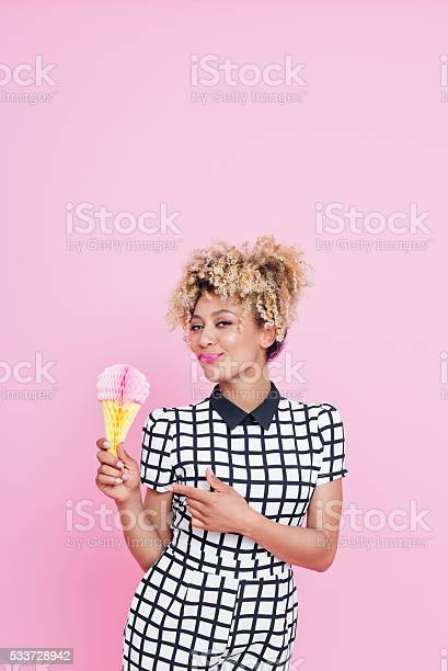 Afro American Young Woman Holding Ice Cream Honeycomb Decorations Stock Photo - Download Image Now