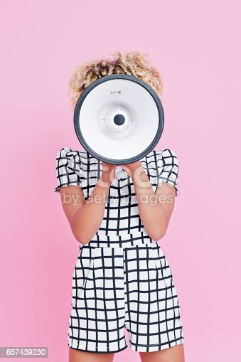 657442382istockphoto Afro american young woman holding megaphone 657439230