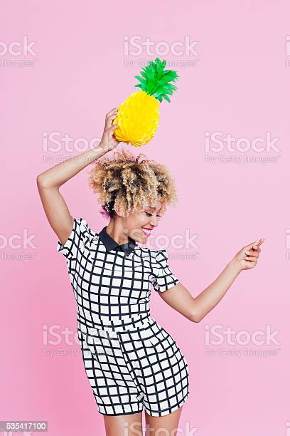Afro American Young Woman Holding Pineapple Honeycomb Decorations Stock Photo - Download Image Now