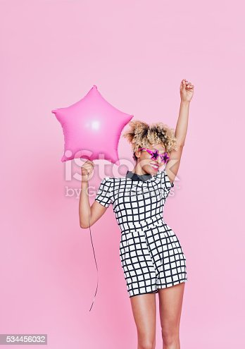 istock Afro American young woman holding Pink Star Foil Balloon 534456032