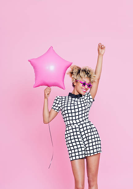 Afro American young woman holding Pink Star Foil Balloon stock photo