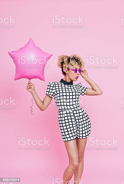 Afro American Young Woman Holding Pink Star Foil Balloon Stock Photo - Download Image Now
