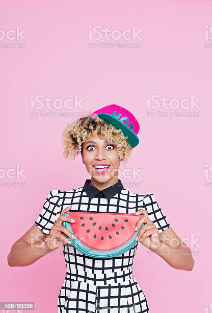Afro American Young Woman Holding Watermelon Bag Stock Photo - Download Image Now
