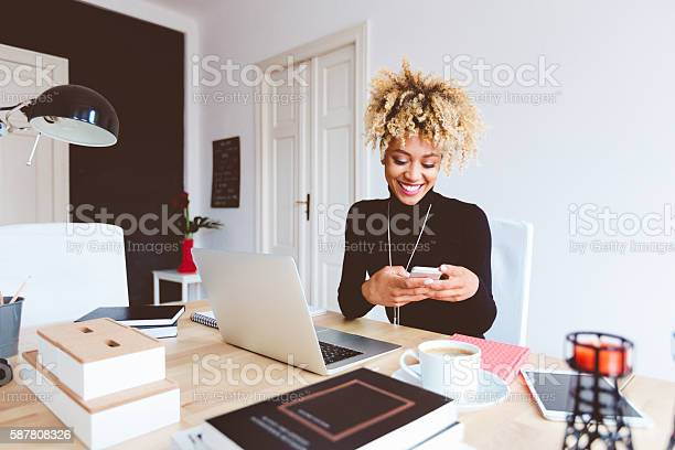 Afro American Young Woman In A Home Office Stock Photo - Download Image Now