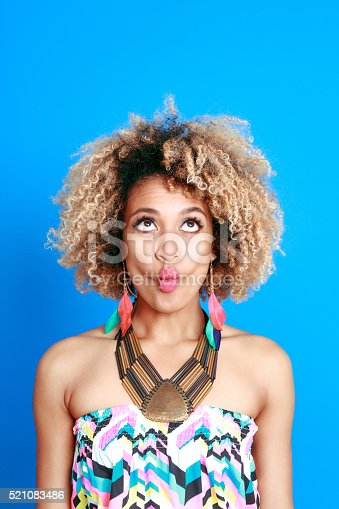 521083232istockphoto Afro american young woman making funny faces 521083486