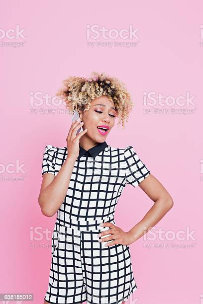 Afro American Young Woman On Her Moble Stock Photo - Download Image Now
