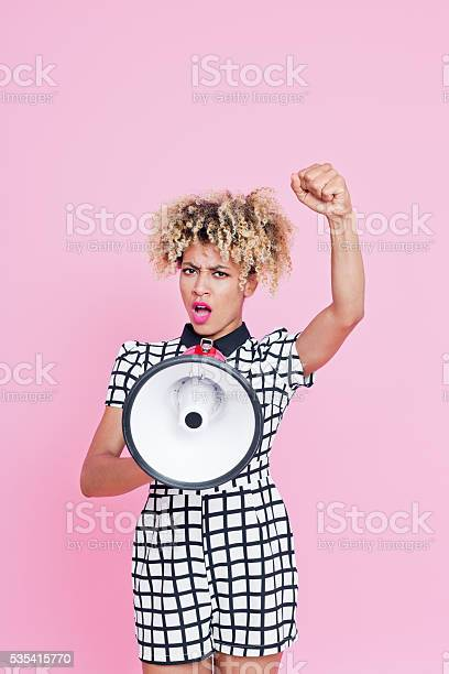 Afro American Young Woman Shouting Into Megaphone Stock Photo - Download Image Now