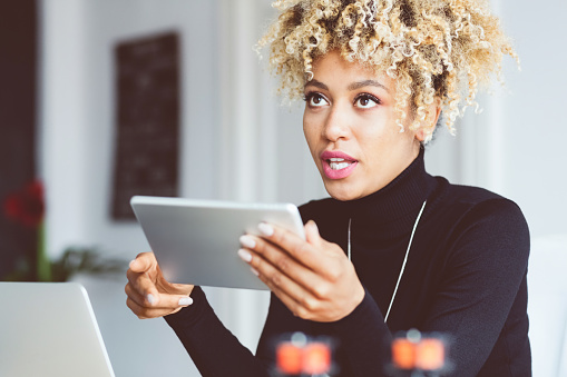 Afro American Young Woman Using Digital Tablet In An Office Stock Photo - Download Image Now