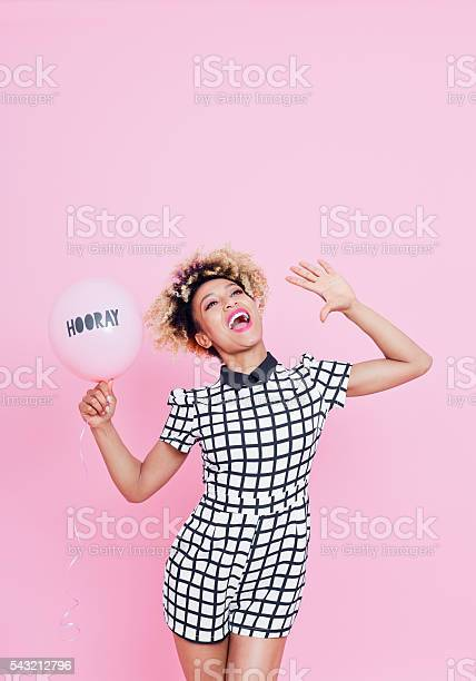 Afro American Young Woman With Hooray Balloon Shouting Stock Photo - Download Image Now