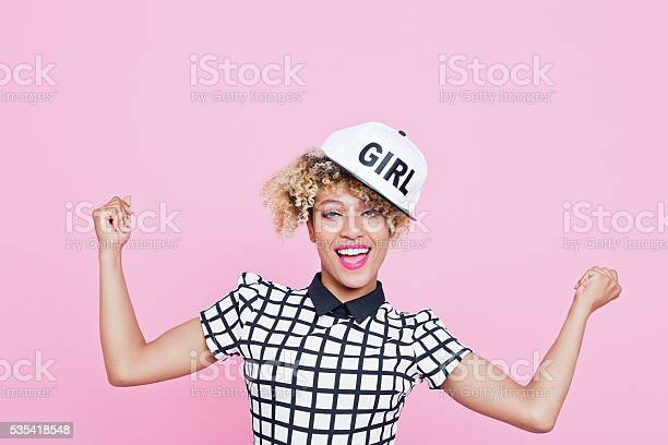 Afro American Young Woman With White Cap Stock Photo - Download Image Now
