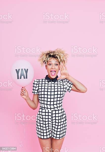 Afro American Young Woman With Yay Balloon Shouting Stock Photo - Download Image Now